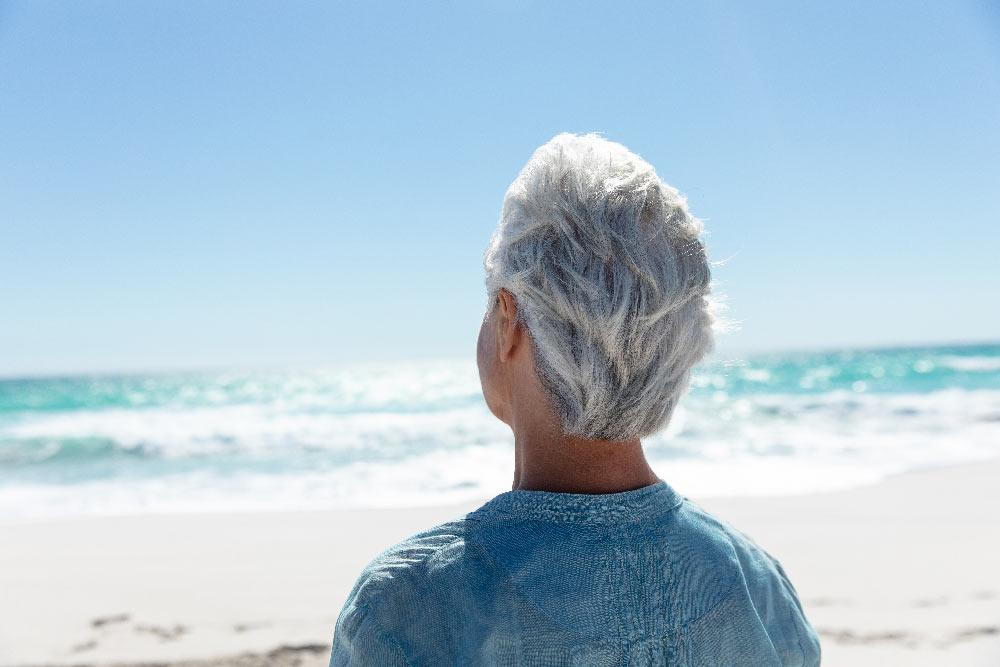 woman back beach retirement
